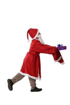 Free Boy In A Cap Santa With A Gift Royalty Free Stock Image - 3888336