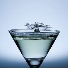 Free Splash Water Isolated On The Champagne Glass. Royalty Free Stock Images - 38926689