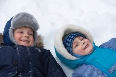 Two  Boys Lay On A Snow Stock Photography
