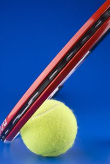 Free Tennis Ball Is Next To A Part Of A Tennis Racket Royalty Free Stock Image - 3903386
