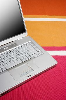Free Laptop On A Colorful Rug Royalty Free Stock Image - 3903716