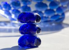 Sunlit Beads On White Table Royalty Free Stock Photo