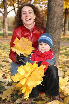 Mother With Son In The Park In Autumn Royalty Free Stock Photo