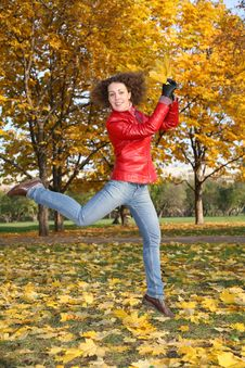 Girl In Red Jacket Jumps In Park Royalty Free Stock Photos