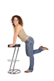 Young Woman And Bar Stool Royalty Free Stock Images