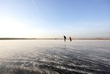 Free Ice Skating On A Wide Open Frozen Lake In Holland Stock Image - 3909961
