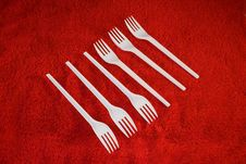 Free Plastic Forks On Red Background Royalty Free Stock Photography - 3920017