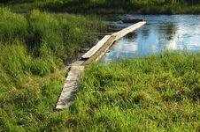 Creek And Footbridge Royalty Free Stock Images