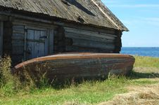 Old Fishing Boat Near The Shed Royalty Free Stock Photo