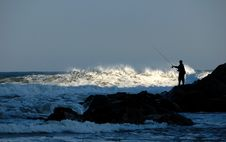 Free Fisherman Silhouette On Rocks Stock Photography - 3929672