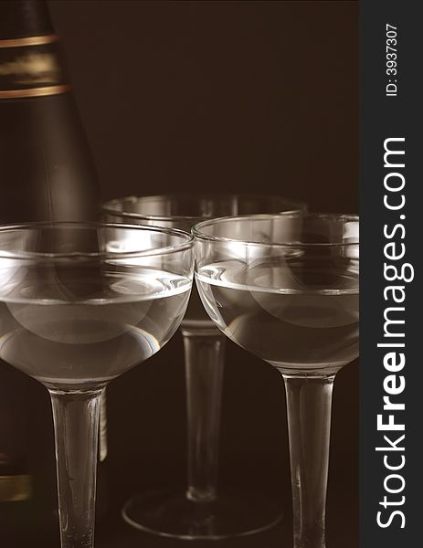 Bottle and goblets on champagne