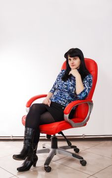 Free Young Beautiful Woman Posing Sitting On A Red Chair Royalty Free Stock Photography - 39356287