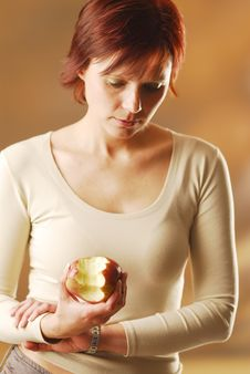 A Woman With An Apple Stock Photo