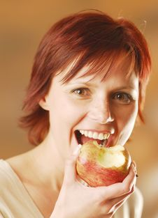 A Woman With An Apple Stock Photography