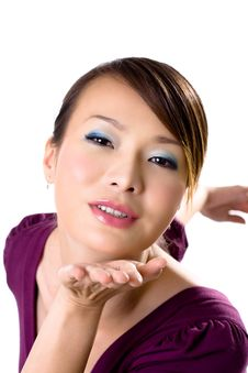 Free Asian Girl Happily Blowing Kiss Stock Photo - 3941370