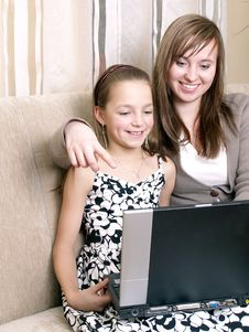 Mother And Daughter Using A Laptop. Stock Images