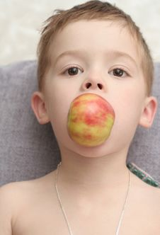 The Boy Which Holds An Apple Stock Photos