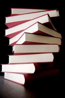 Free Books Stacked Up Over Black Stock Photos - 3950703