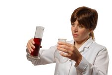 Free Young Lady Scientist Pours Liquid Royalty Free Stock Image - 3958936