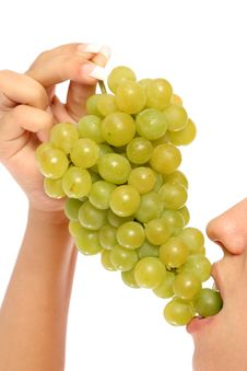 Girl With A Cluster Of Green Grapes Stock Image