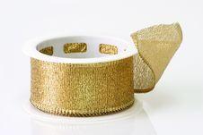 A Spool Of Golden Girft Wrapping Ribbon Stock Photos