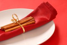 Free Red Napkin On A White Plate With Cinammon Sticks Stock Images - 3961374