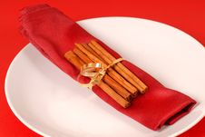 Free Cinammon Sticks Wrapped In A Red Napkin Royalty Free Stock Image - 3961376