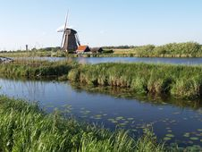 Windmill And River Stock Photography