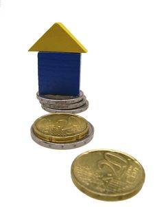 Toy House On Coins Of Euro Stock Photography