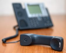 Free Telephone Receiver With Phone On Background Royalty Free Stock Image - 3974456