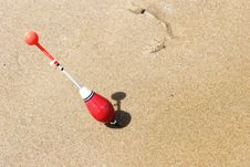 A Fishing Float Sticked Into The Sand Stock Image