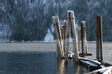 Pilings In Mountain Lake Stock Photo