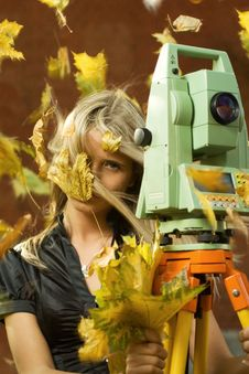 Girl And Total Station Royalty Free Stock Photos