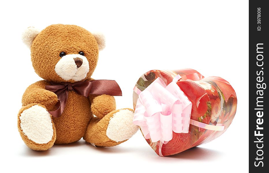 Classic brown Teddy Bear with heart-shaped present