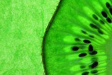 Slice Of Kiwi Fruit On Rough Green Royalty Free Stock Photography