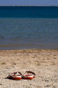 Free Slippers On The Beach Royalty Free Stock Photos - 3982818