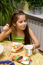 Free The Girl Sits At A Table With Meal And Eats Stock Photo - 3994140