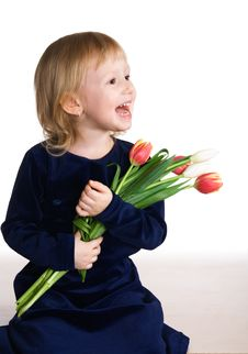 Free Small Joyrful Girl With Tulips Stock Photo - 3992160