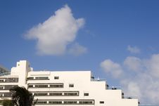 White Terraced Hotel And Clouds Stock Image