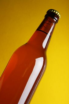 Free Beer Bottle Over Yellow Royalty Free Stock Photo - 3993045