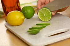 Slicing A Lime Royalty Free Stock Image