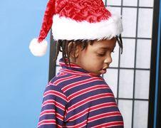 Little Boy In A Santa Hat Stock Photo