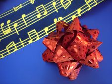 Free Red Bow And Golden Music Stock Photography - 402832