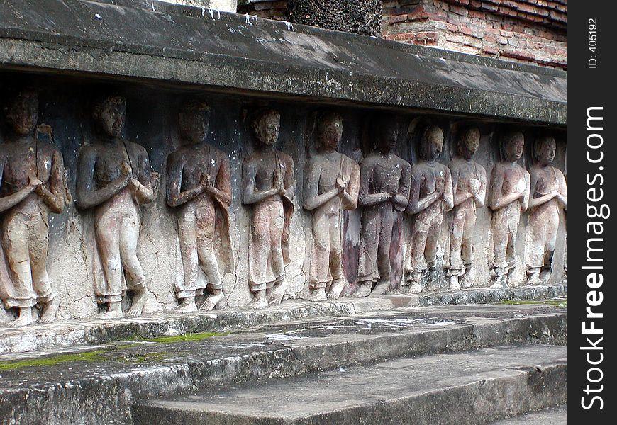 Praying Figurines