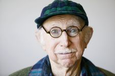 Senior Man In A Hat And Glasses Royalty Free Stock Images