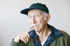 Free Thoughtful Senior Man In A Hat And Glasses Stock Photography - 4002382