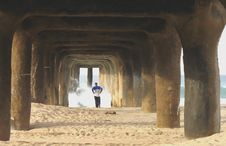 Runner Under Pier Royalty Free Stock Images