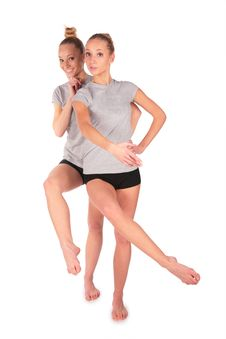 Twin Sport Girls Posing Balancing Stock Image