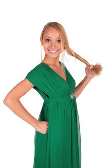 Girl In Green Holding Her Plait Royalty Free Stock Photography