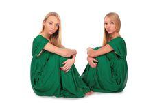 Free Twin Girls Sitting On Floor Stock Photo - 4004040